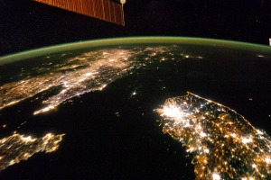 NASA image taken by the Expedition 38 crew aboard the ISS shows night view of the Korean Peninsula